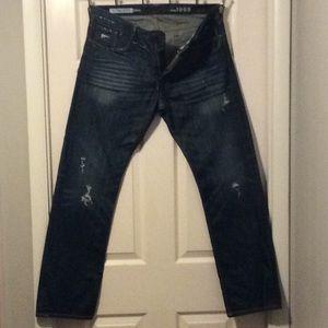 Men's distressed blue jeans